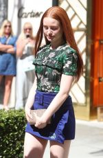 Madelaine Petsch Attends the Tory Burch party and looks happy to be leaving with her goody bag in Beverly Hills