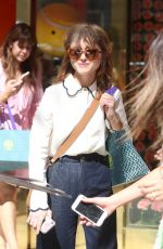 Natalia Dyer Attends the Tory Burch party while fans attempt to get her autograph in Beverly Hills
