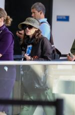 Winona Ryder and Scott Mackinlay Hahn make their way to the security check point ahead of their flight out of Los Angeles