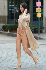 Adriana Lima In beige and nude colored ensemble during a photoshoot in NYC