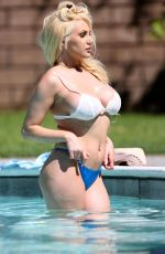 Courtney Stodden Cools off at the pool in tiny bikini in Palm Springs