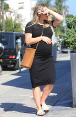 Hilary Duff and her HUGE baby bump made a trip to her favorite coffee shop this morning in LA
