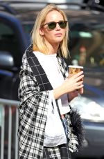 Jennifer Lawrence Steps out wearing a Plaid cape-scarf as she Vapes and drinks her coffee