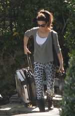 Kate Beckinsale Pulls a suitcase to her car in Los Angeles