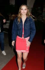 Lily-Rose Depp In a bright red wrap dress during the 5th International Film Festival of St Jean de Luz in France