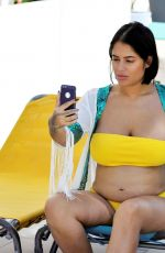 Malin Andersson Flashes her baby bump in a yellow bikini in Spain
