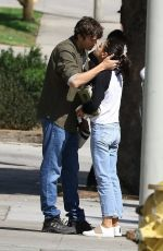 Mila Kunis and Ashton Kutcher share a passionate kiss before parting ways in Los Angeles