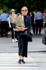 Naomi Watts Carrying her groceries home after shopping at Whole Foods in New York