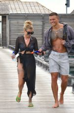 Olivia Buckland Takes a romantic pier walk on Maldives Honeymoon