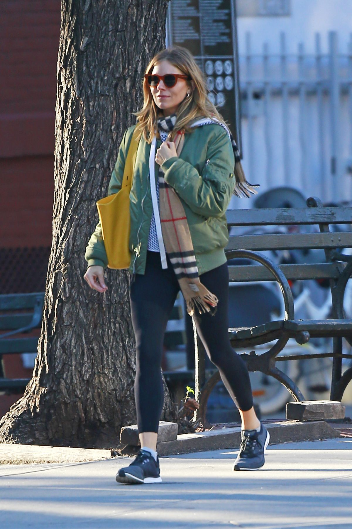 0136e61bc Sienna Miller Wears a green bomber jacket paired with tights and ...
