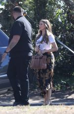 Sofia Vergara Is scored by a security guard to her car on the set of