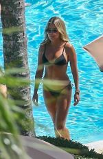 Sylvie Meis In a bikini by the poolside in Miami