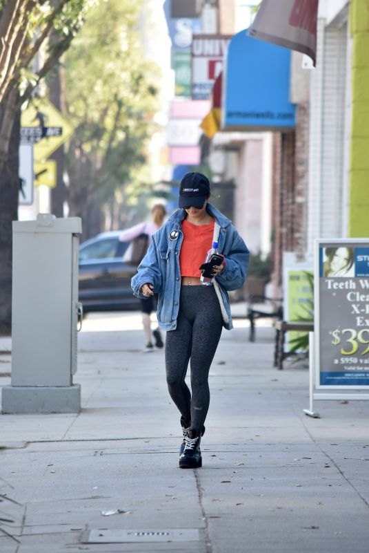 Vanessa Hudgens Out and about wearing a denim jacket, sunglasses, a peak cap and leggings in Los Angeles