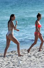 Alana Hadid and Marielle Hadid At the beach with their mother Mary Butler in Miami Beach