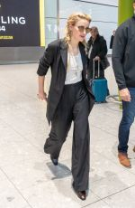Amber Heard Arrives at Heathrow Airport to attend the premiere of Aquaman in London