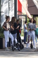 Amelia and Delilah Hamlin are having the time of their lives on scooters in West Hollywood