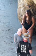 Ashley Graham In white swimsuit at the beach in Malibu