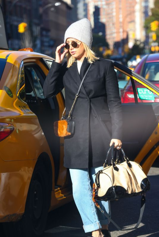 Ashley Tisdale Exiting a taxi cab in NYC