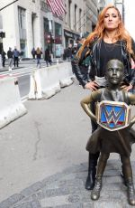 Becky Lynch Poses with the Fearless Girl statue in the Wall Street area New York City