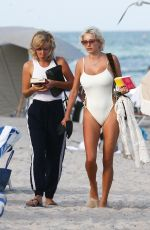 Caroline Vreeland In a white swimsuit as she hits the beach in Miami