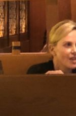Charlize Theron Enjoys a night on the town with family in Hollywood