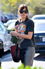 Dakota Johnson Shopping for groceries and flowers at Erewhon Market