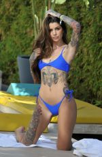 Darylle Sargeant Shows off her tattoos in blue bikini on Ibiza