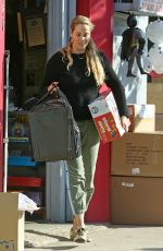 Elizabeth Berkley Loads her car with shopping bags after toy shopping with her son Sky at Star Toys in Brentwood