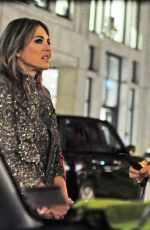 Elizabeth Hurley In leather jeans as she spends the night with a mystery man in London