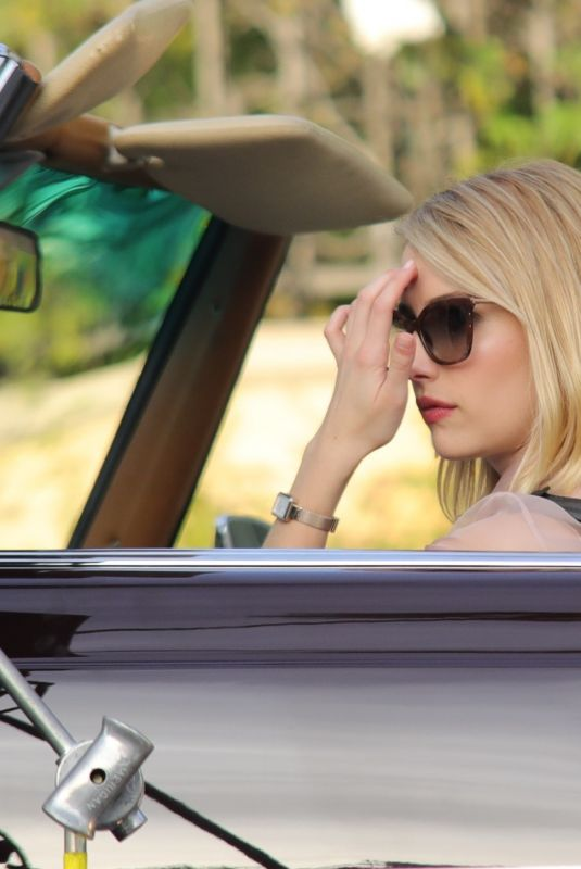 "Emma Roberts ""Drives"" a vintage car while filming for one of her latest projects in Beverly Hills"