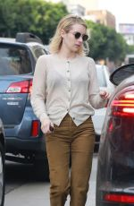 Emma Roberts Opts for a sheer cardigan for a meeting at an office building in Hollywood