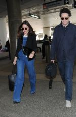 Felicity Jones With her husband Charles Guard at LAX Airport