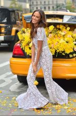 Joan Smalls Brightens up a street during a photoshoot with a cab full of daisies in NYC