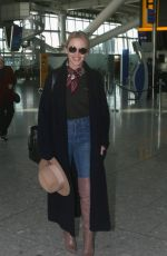 Kylie Minogue Arrives at Heathrow Airport in London