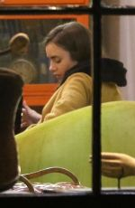 Lily Collins Enjoying some evening writing time at a local coffee shop in LA