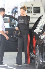 Lori Laughlin Drops her car off at valet as she goes shopping in the 90210 area