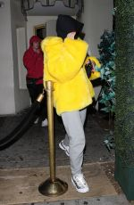 Noah Cyrus In a yellow fur coat as she is seen leaving the Delilah restaurant with a male companion in West Hollywood