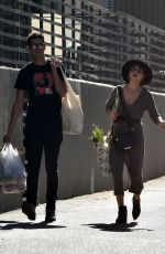 Sarah Hyland and Wells Adams get busy shopping around Los Angeles Farmer