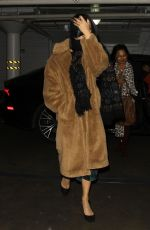 Vanessa Hudgens Hiding behind her phone as she arrived at Katana in West Hollywood