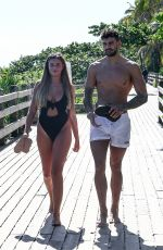 Zara McDermott In a black swimsuit as she hits the beach in Miami