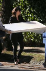 Amanda Seyfried Has an art frame delivered to her house in Los Angeles