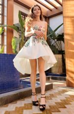 Blanca Blanco In a white, floral print dress for a photoshoot in Morocco