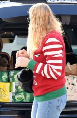 Busy Philipps Wears her favorite Christmas sweater during a grocery run