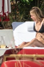 Chloe Sevigny Relaxing with a friend poolside at the Faena Hotel in Miami