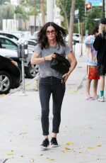 Courteney Cox Shopping for carpets at Decorative Carpets By Stark in West Hollywood