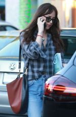 Dakota Johnson Does some last minute Christmas shopping at Everything But Water and a few other stores in Beverly Hills
