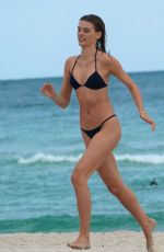Daphne Groeneveld and Madison Headrick hit the beach with fellow model friends in Miami Beach