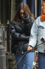 Emily Ratajkowski Hides from the shutterbugs on a afternoon stroll with a friend in New York