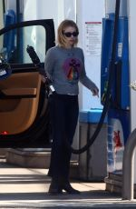 Emma Roberts Stops by a gas station in Hollywood