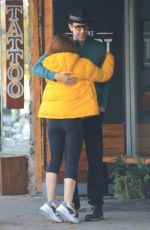 Isla Fisher and husband Sacha Baron Cohen share a romantic hug after having lunch in Studio City